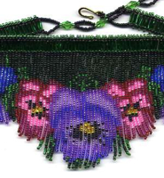 Beadwork in fringe designs that show up when worn